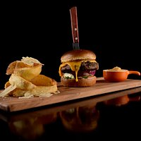 Our yummy bacon and cheddar or pulled pork burgers served with chips