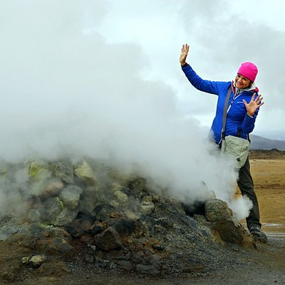 Namaskard in Myvatn area - lady poses next to a fumarole.