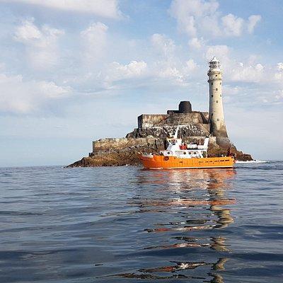 Dun na Oir II rounding the Fastnet Rock Lighhouse