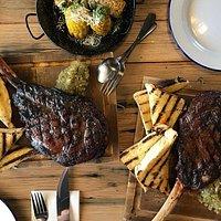 Cowboy Steak - a true Tomahawk – 1.2kgs cut from the forerib! - Photo by Ryan Smiles