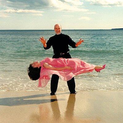 Viktor Zenko Performs a levitation on the beach.