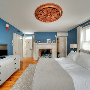 Room #3 consists of original hardwood floors from the 1800's, a king size bed, & luxurious en su