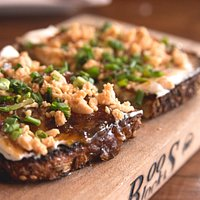 Fig & Goat Cheese: Fig jam, olive oil whipped goat cheese, crushed marcona almonds, green onion