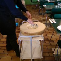 Traditional Italian pasta served at your table from inside a parmesan wheel enhancing the flavou