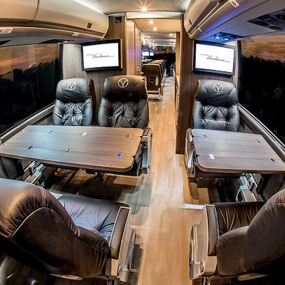 Vonlane motor coaches are outfitted with a conference area to allow productivity.