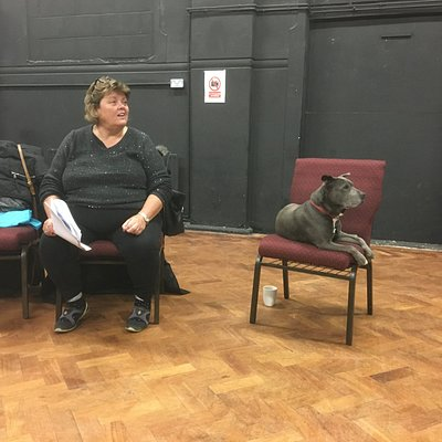 Two cast members awaiting their moment on stage in the cornerHOUSE arts centre