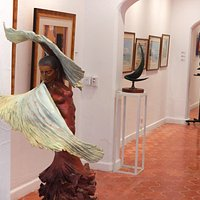 A glance in the Demetro Gallery, with Jim Demetro's female flamenco dancer. in the foreground.