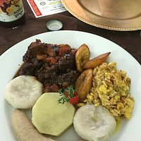 Ackee and salt fish with green bananas, dumplings and stew chicken