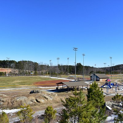 Baseball fields, basketball courts, playground, walking path, and tennis courts.