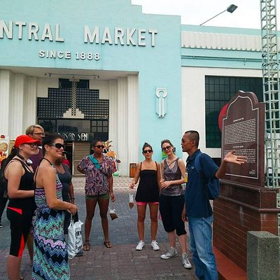 Snapshot of our tour guide Zahren telling the local street stories to a group of travelers.