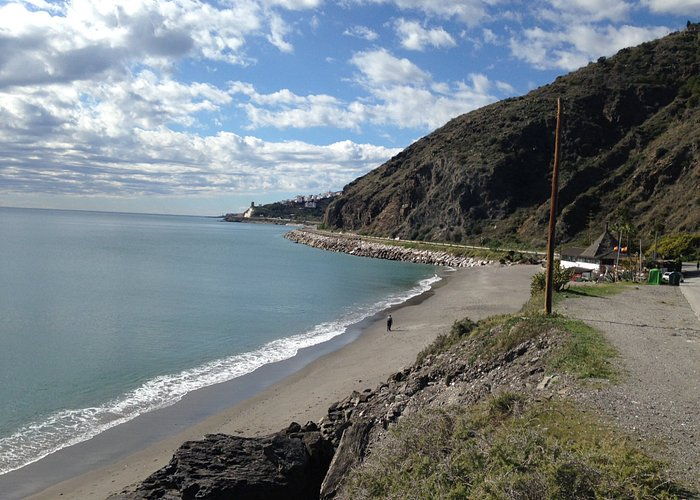 View across beach towards Torrox from parking area