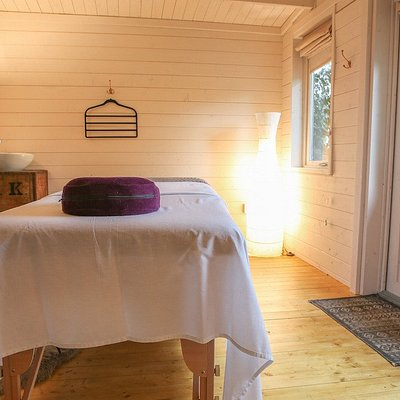The Massage Hut is situated in a secluded area, surrounded by trees and birdsong.