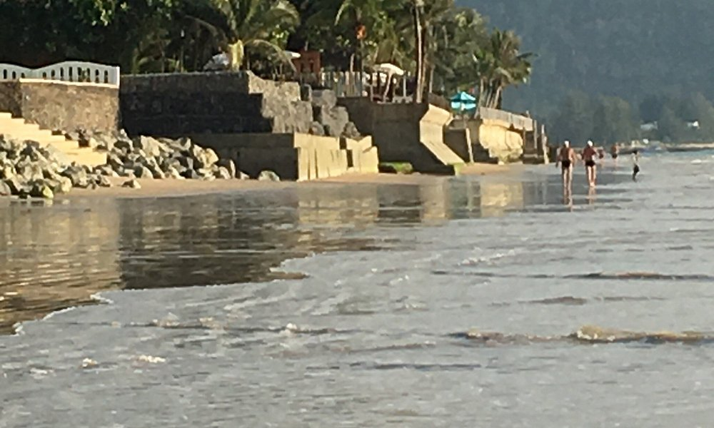 Destroyed beach due to berried debris and concrete walls 👎