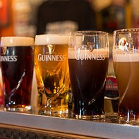 From left to right: red fruit beer, lager, Guinness and Kilkenny getting settled.