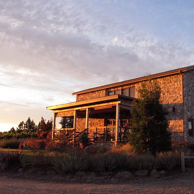 View of the tasting room, glowing in the golden light of an Oregon sunset.
