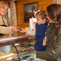 Jackie greeting customers