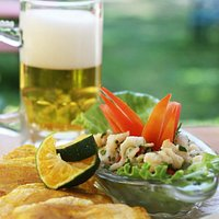 costa rican fish specialty ceviche with patagones, fried big banana chips