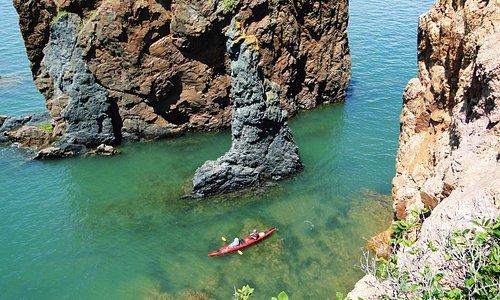 Kayaking through the Three Sisters sea stacks