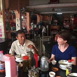 Taking tourist to eat where Cambodian people eat.