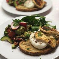 Za'atat Eggs served with Grilled Halloumi, Nocellara Olives, Radish, Cucumber & Tomato Salad.