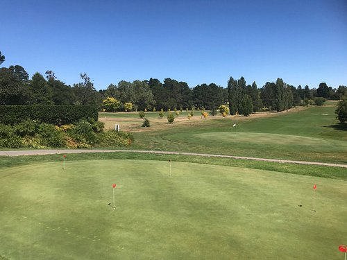 The view over the practice green, towards the 18th green and fairway