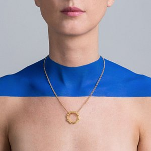 Versatile necklace with a unique recognizeable iconic gear in gold or platinum plated silver