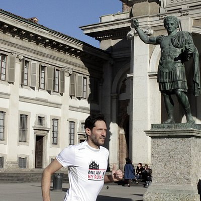 Running by Constantine the Great statue in a Top Milan running tour