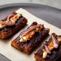 Fried squid toast, smoked almond cream, yuzu kosho chermoula, native mint.