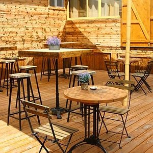 Our outdoor deck by the visitor's center, the perfect setting for a glass of wine!