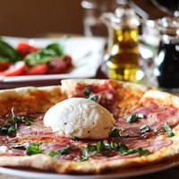 Thin crust Pizza with Imported fresh mozzarella from Italy