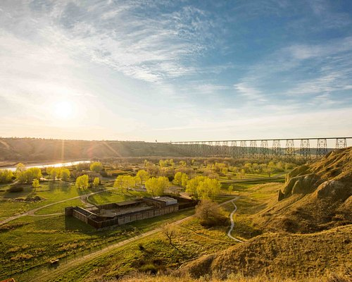 An aerial photo taken of the fort and Oldman River valley from above the coulees during sunset