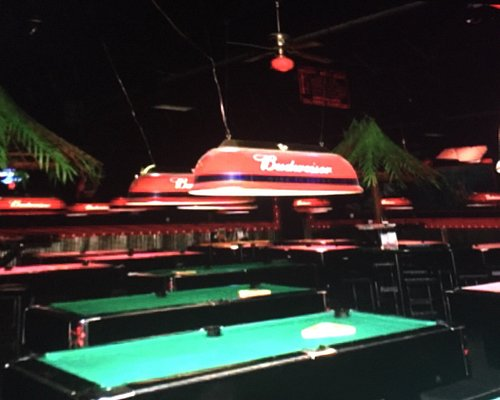 """Green tables are """"bar"""" style, pink ones are larger. Rent by the hour, no quarters needed!"""