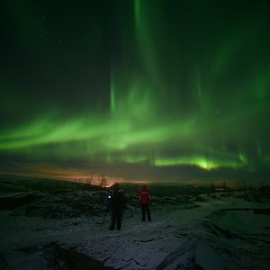 alone in the mountains with the northern lights