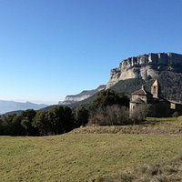 View of valley and Esglesia de Sant Joan de Fabregas, near Rupit, Catalonia, Spain