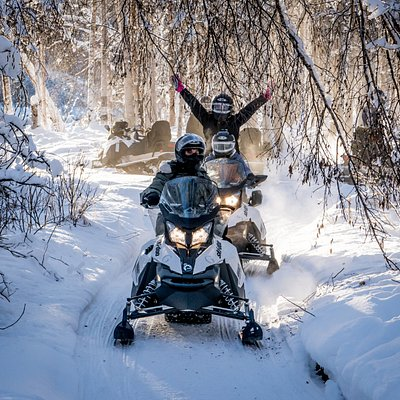 Enjoying the warm sunshine on a snowmobile ride