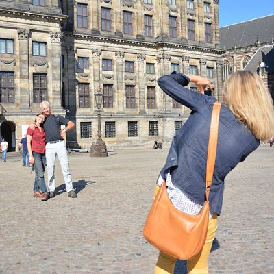 ToursByLocals guide Yvonne snaps photos for travellers on a walking tour of Amsterdam