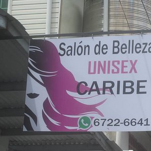 The sign in front of the beauty salon.