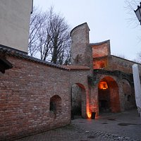 Old city wall with the gate that leads to the Sempt river.
