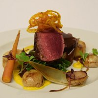 Venison, potato fondant, baby turnips and a trio of carrots