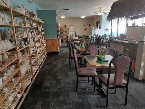Ceramic room with customer seating.  Tiki Hut!!