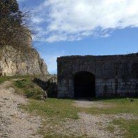 Fort San Carlos at end of road behind statue
