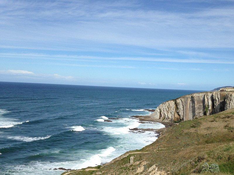 Looking along cliffs towards beach area