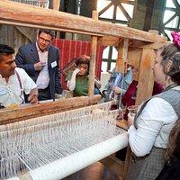 fidel the teacher showing the weaving in pedal loom