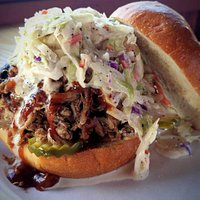 Our Big Hog! Jalapeno relish mustard, pickles, pulled pork, slaw, and our Sweet Gerogia Sauce