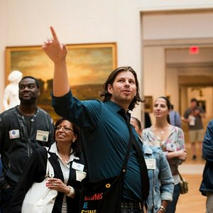 Renegade Guide Kevin leading a group through the Metropolitan Museum of Art