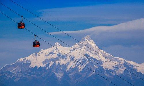 Gondola ride with mountain view.