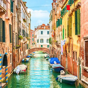 The minor canals of Venice burst with colour and life