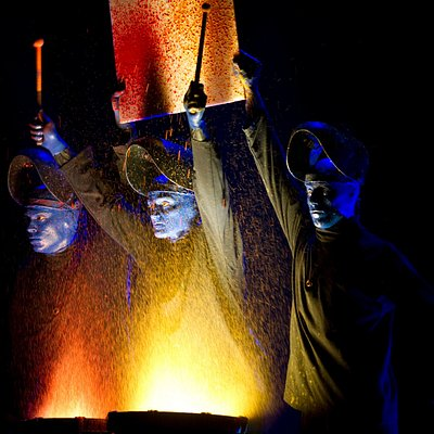 Dare to live (and drum) in full color with Blue Man Group!
