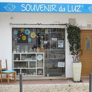 Souvenir da Luz - the chair outside is for the men whilst their women browse!  How thoughtful.
