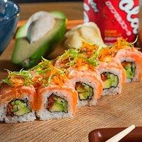 Roll with salmon, fresh cucumber, avocado and tobiko caviar.